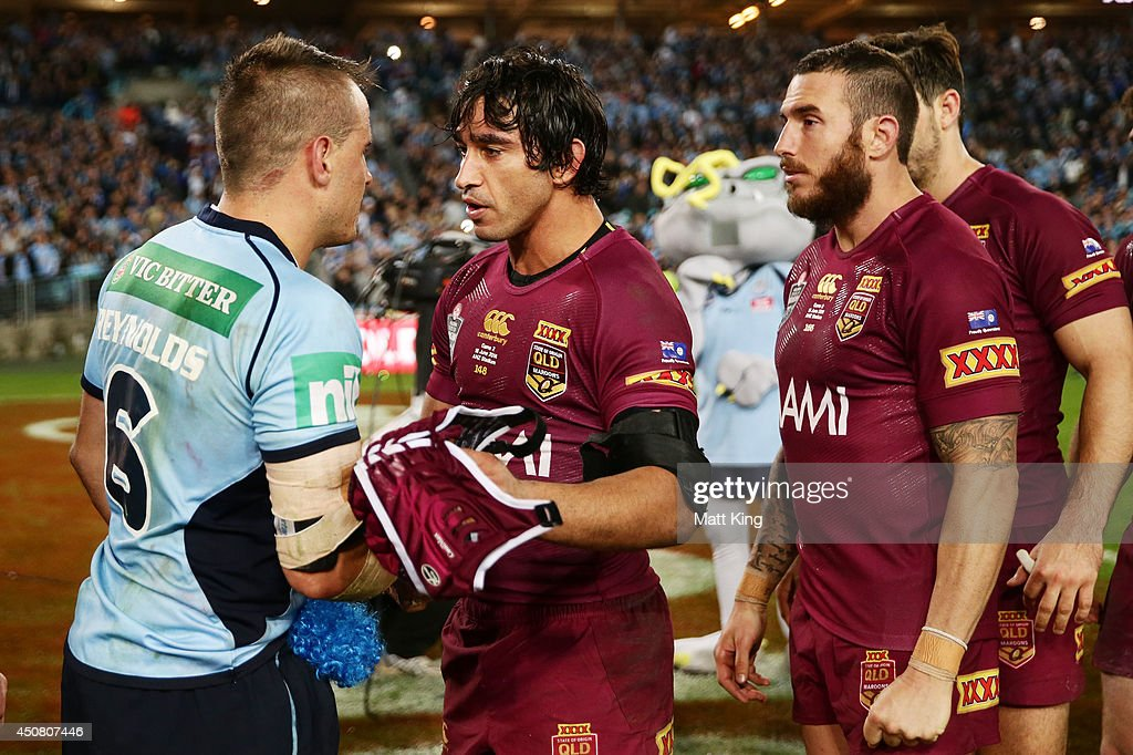Johnathan Thurston of the Maroons speaks to Josh Reynolds of the Blues after game two of the State of Origin series between the New South Wales Blues and the Queensland Maroons at ANZ Stadium on June 18, 2014 in Sydney, Australia.