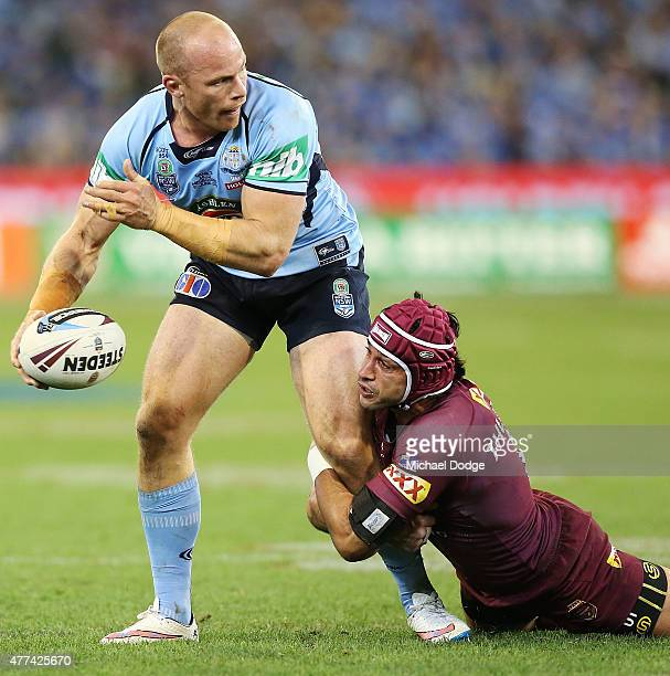 Johnathan Thurston of the Maroons tackles Beau Scott of the Blues during game two of the State of Origin series between the New South Wales Blues and...