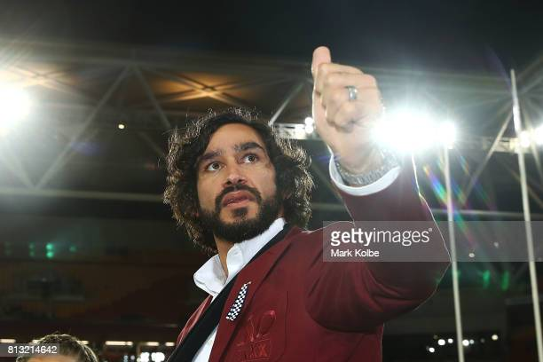 Johnathan Thurston of the Maroons waves to the crowd as he celebrates victory after game three of the State Of Origin series between the Queensland...
