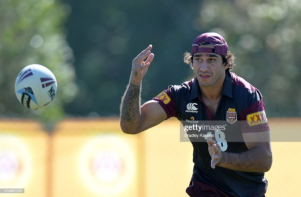Johnathan Thurston passes the ball during the Queensland Maroons State of Origin training session at Sanctuary Cove on May 24, 2015 in Brisbane, Australia.