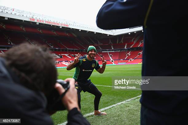 Johnathan Thurston poses on the pitch as Cameron Smith takes a photograph on his mobile phone ahead of the Australia training session at Old Trafford...