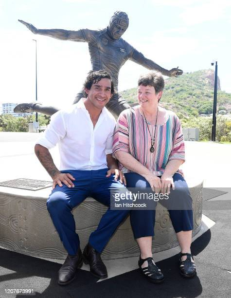 Johnathan Thurston poses with artist Jane Hawkins during the unveiling of the Jonathan Thurston bronze statue at the Queensland Country Bank Stadium...