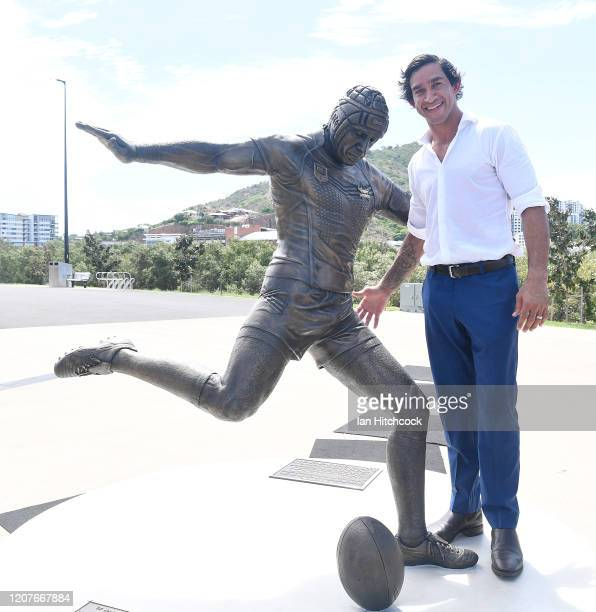 Johnathan Thurston poses with his statue during the unveiling of the Jonathan Thurston bronze statue at the Queensland Country Bank Stadium on...