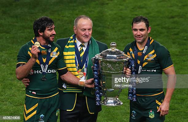 Johnathan Thurston Tim Sheens and Cameron Smith of Australia celebrate with the Rugby League World Cup after victory over New Zealand in the Rugby...