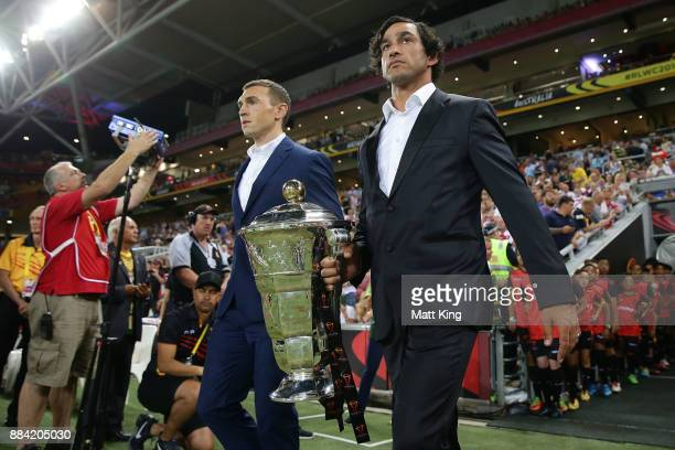 Johnathan Thurston walks out with the Rugby League World Cup before the 2017 Rugby League World Cup Final between the Australian Kangaroos and...