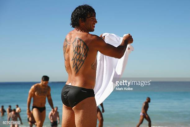 Johnathan Thurston watches on during the Australia Kangaroos Test team recovery session at Coogee Beach on May 2 2016 in Sydney Australia