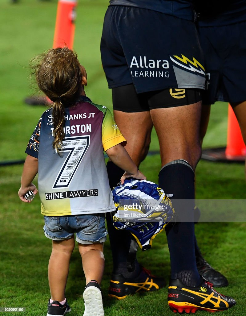 Johnathan Thurston's daughter Charlie looks up at her father at the end of the round one NRL match between the North Queensland Cowboys and the Cronulla Sharks at 1300SMILES Stadium on March 9, 2018 in Townsville, Australia.
