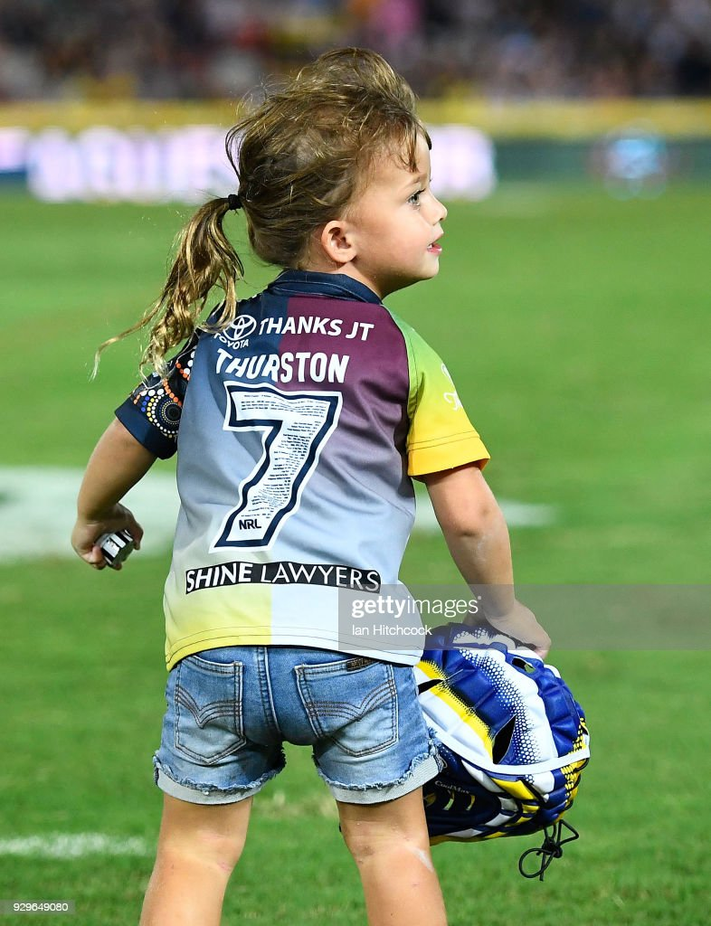 Johnathan Thurston's daughter Charlie runs with his headgear at the end of the round one NRL match between the North Queensland Cowboys and the Cronulla Sharks at 1300SMILES Stadium on March 9, 2018 in Townsville, Australia.