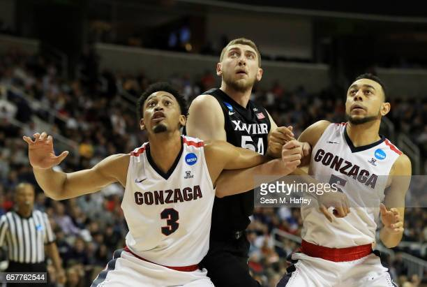 Johnathan Williams and Nigel WilliamsGoss of the Gonzaga Bulldogs vie for position with Sean O'Mara of the Xavier Musketeers in the first half during...