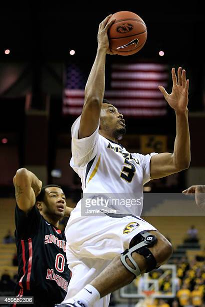 Johnathan Williams III of the Missouri Tigers drives to the basket as Josh Langford of the Southeast Missouri State Redhawks looks on during the game...