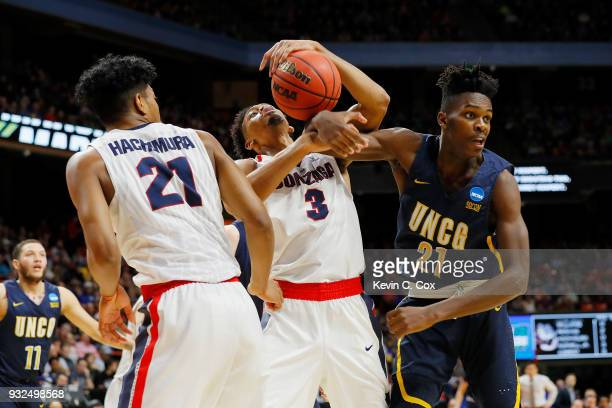 Johnathan Williams of the Gonzaga Bulldogs battles for a rebound against James Dickey of the UNCGreensboro Spartans in the first half during the...