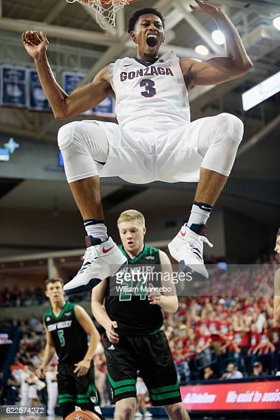 Johnathan Williams of the Gonzaga Bulldogs celebrates his dunk shot against the Utah Valley Wolverines in the second half at McCarthey Athletic...