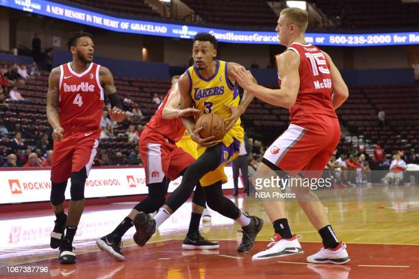 Johnathan Williams of the South Bay Lakers drives against Markel Crawford Dusty Hannahs and Tanner McGrew of the Memphis Hustle during an NBA GLeague...