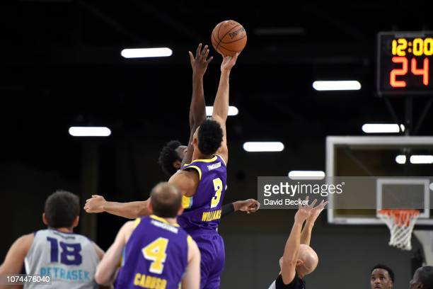 Johnathan Williams of the South Bay Lakers jumps for the opening tipoff against the Greensboro Swarm during the NBA G League Winter Showcase on...