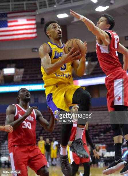 Johnathan Williams of the South Bay Lakers shoots against Yuta Watanabe and Kyle Casey of the Memphis Hustle during an NBA GLeague game on December 1...