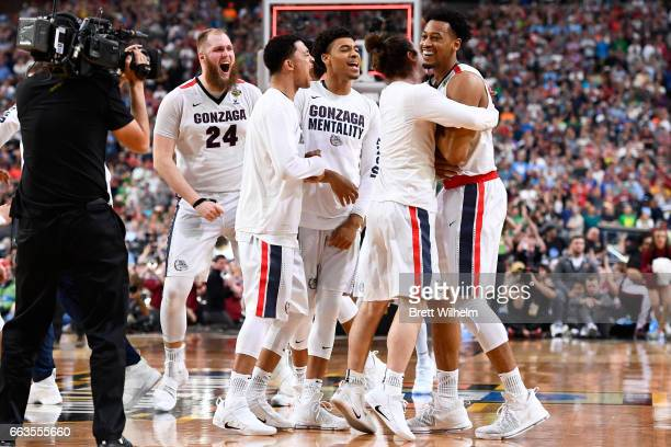 Johnathan Williams Przemek Karnowski of the Gonzaga Bulldogs and teammates react after the final play during the 2017 NCAA Men's Final Four Semifinal...