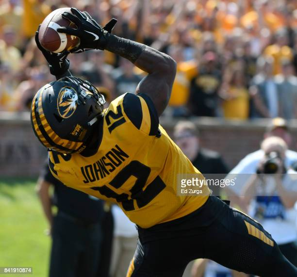Johnathon Johnson of the Missouri Tigers catches a pass for a touchdown against the Missouri State Bears in the first quarter at Memorial Stadium on...