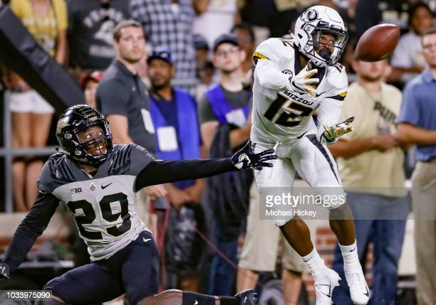 Johnathon Johnson of the Missouri Tigers looks to catch the ball as Simeon Smiley of the Purdue Boilermakers defends during the first half at RossAde...