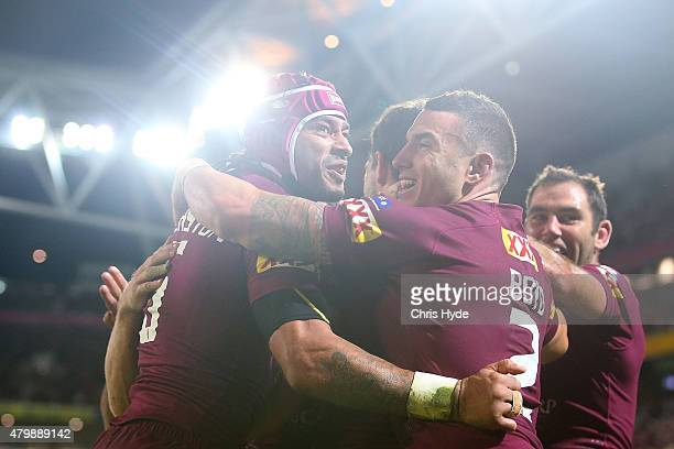 Johnathon Thurston and Michael Morgan of the Maroons celebrate a try during game three of the State of Origin series between the Queensland Maroons...