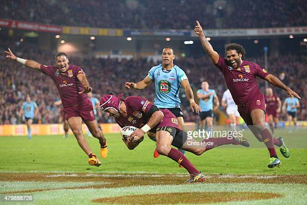 Johnathon Thurston of the Maroons scores a try before being disallowed during game three of the State of Origin series between the Queensland Maroons...