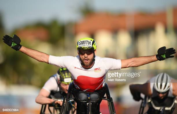 Johnboy Smith of England celebrates as he crosses the line to win silver in the Men's T54 marathon on day 11 of the Gold Coast 2018 Commonwealth...