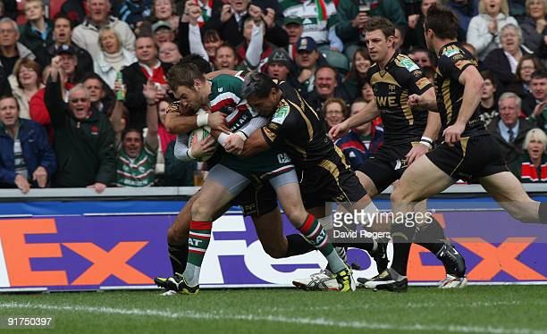 Johne Murphy of Leicester powers through the Ospreys defence to score the first try during the Heineken Cup match between Leicester Tigers and...