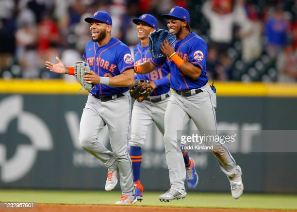 Johneshwy Fargas, Khalil Lee and Dominic Smith of the New York Mets celebrate their win after an MLB game against the Atlanta Braves at Truist Park...