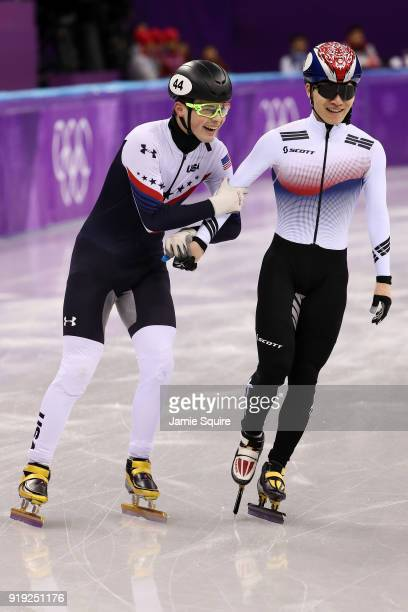 JohnHenry Krueger of the United States and Yira Seo of Korea celebrate after coming in first and second in their race during the Short Track Speed...