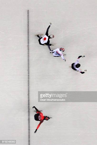 JohnHenry Krueger of the United States crosses the finish line first ahead of Yira Seo of Korea Ryosuke Sakazume of Japan and Charles Hamelin of...