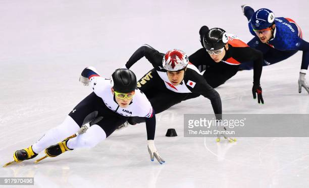 JohnHenry Krueger of the United States Farrell Treacy of Great Britain Shaoang Liu of Hungary Ryosuke Sakazume of Japan compete in the Short Track...