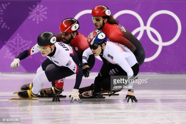 JohnHenry Krueger of the United States Yira Seo of Korea Charles Hamelin of Canada Samuel Girard of Canada compete during the Short Track Speed...