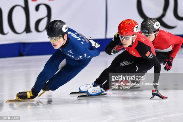 JohnHenry Krueger of the USA competes against Hongzhi Xu of China in the men's 1000 meter preliminaries during the World Short Track Speed Skating...