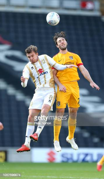 JohnJoe O'Tooe of Northampton Town contests the ball with Alex Gilbey of Milton Keynes Dons during the Sky Bet League Two match between Milton Keynes...