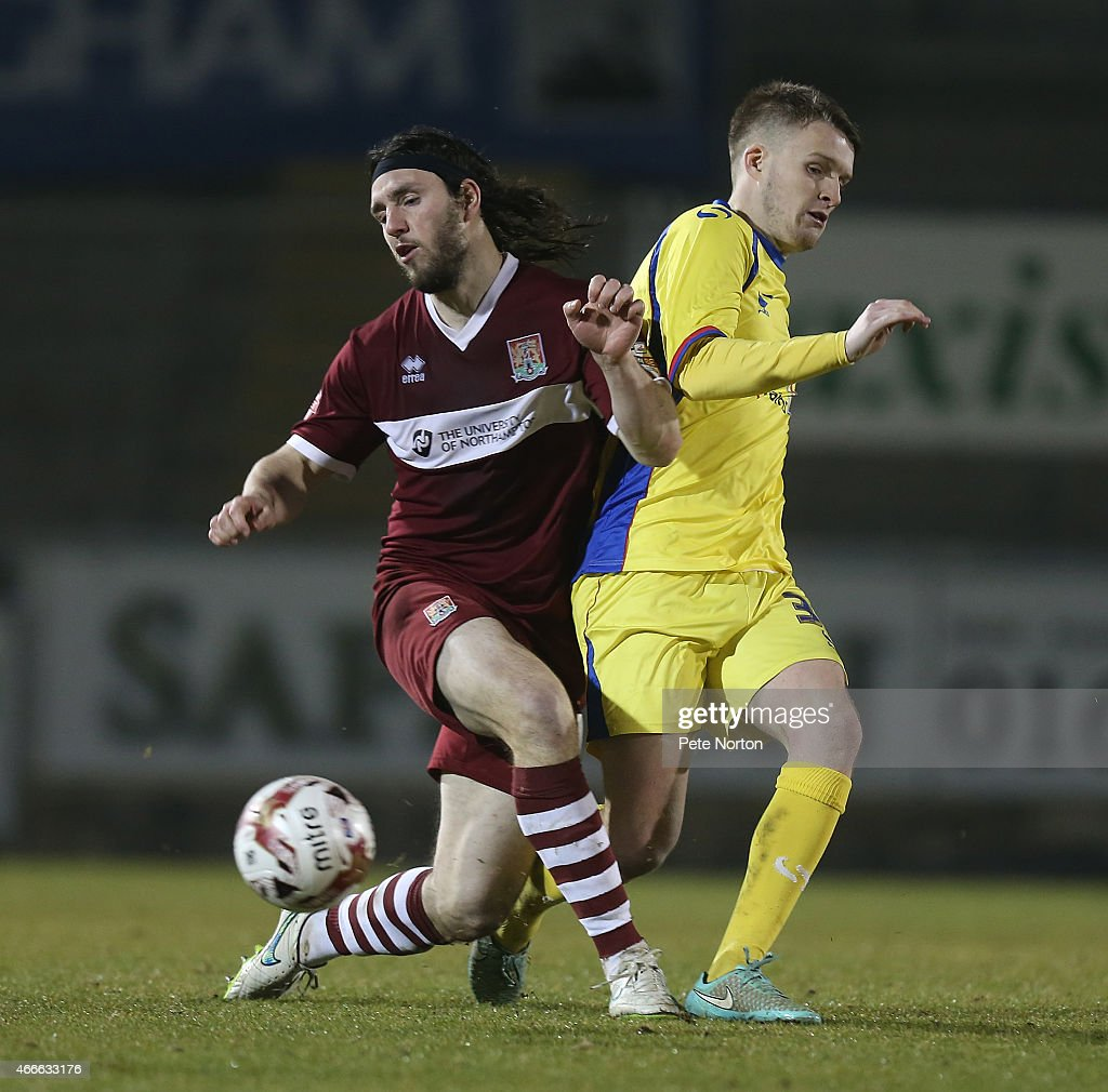 John-Joe O'Toole of Northampton Town challenges for the ball with Paul Corry of Carlisle United during the Sky Bet League Two match between Northampton Town and Carlisle United at Sixfields Stadium on March 17, 2015 in Northampton, England.