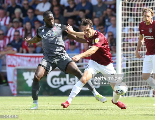 JohnJoe O'Toole of Northampton Town contests the ball with John Akinde of Lincoln City during the Sky Bet League Two match between Northampton Town...