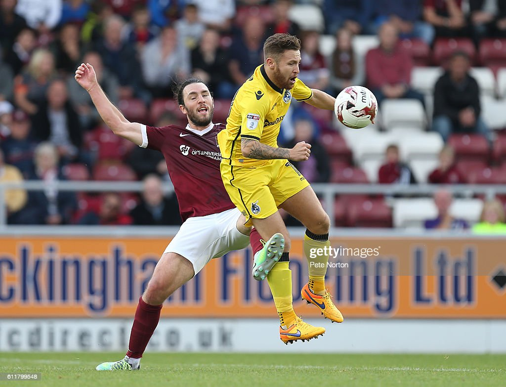 John-Joe O'Toole of Northampton Town contests the ball witth Matty Taylor of Bristol Rovers during the Sky Bet League One match between Northampton Town and Bristol Rovers at Sixfields Stadium on October 1, 2016 in Northampton, England.
