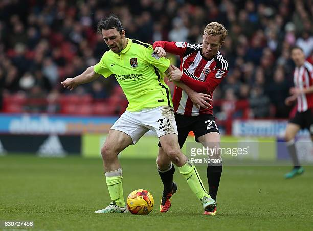 JohnJoe O'Toole of Northampton Town controls the ball under pressure from Mark Duffy of Sheffield United during the Sky Bet League One match between...