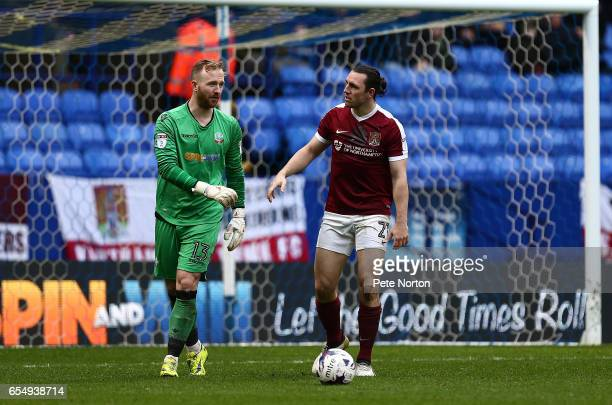 JohnJoe O'Toole of Northampton Town looks to Ben Alnwick of Bolton Wanderers after a clash during the Sky Bet League One match between Bolton...