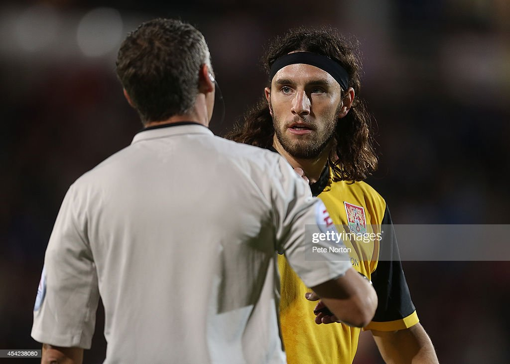 John-Joe O'Toole of Northampton Town looks to referee Carl Berry during the Capital One Cup Second Round match between AFC Bournemouth and Northampton Town at Goldsands Stadium on August 26, 2014 in Bournemouth, England.