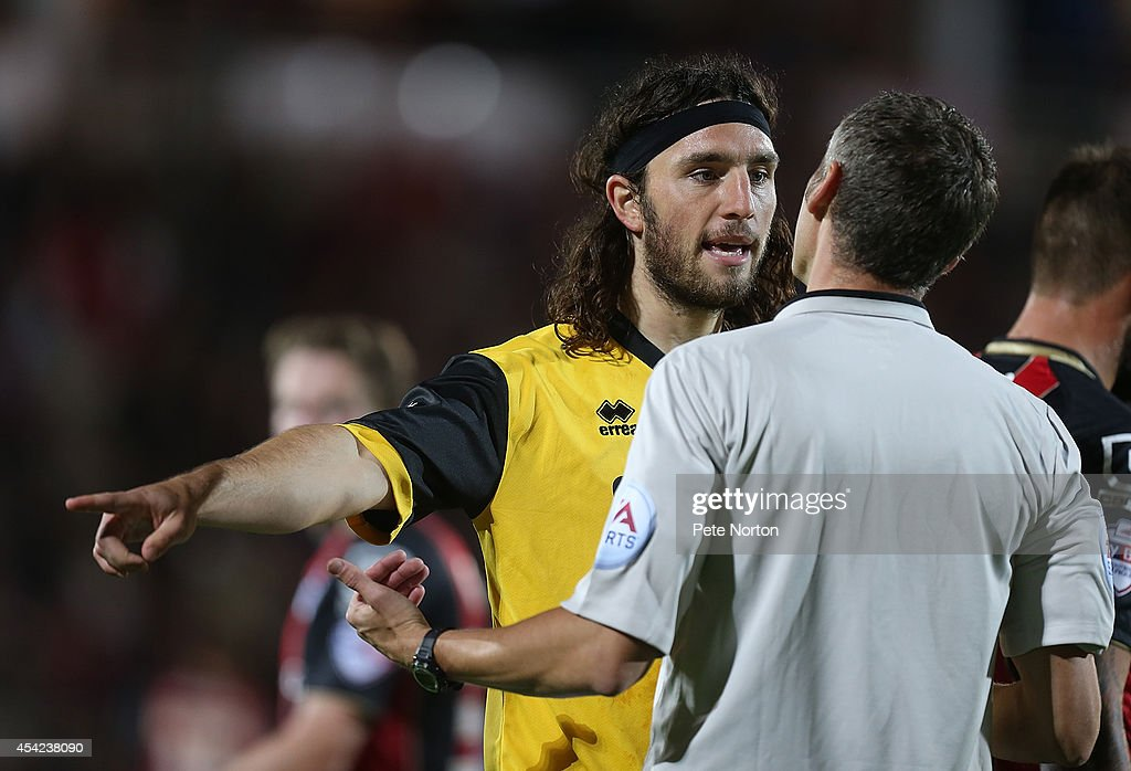 John-Joe O'Toole of Northampton Town makes a point to referee Carl Berry during the Capital One Cup Second Round match between AFC Bournemouth and Northampton Town at Goldsands Stadium on August 26, 2014 in Bournemouth, England.