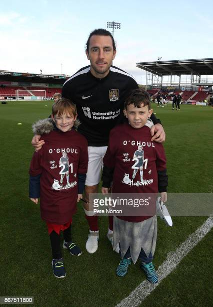 John-Joe O'Toole of Northampton Town poses with two fans wearing Halloween T-Shirts during the Sky Bet League One match between Northampton Town and...
