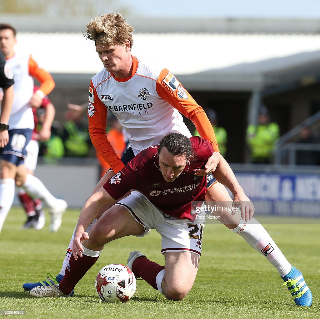 John-Joe O'Toole of Northampton Town under pressure from Cameron McGeehan of Luton Town during the Sky Bet League Two match between Northampton Town and Luton Town at Sixfields Stadium on April 30, 2016 in Northampton, England.