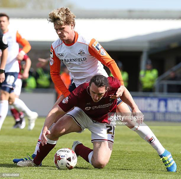 JohnJoe O'Toole of Northampton Town under pressure from Cameron McGeehan of Luton Town during the Sky Bet League Two match between Northampton Town...