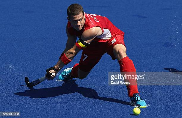 JohnJohn Dohmen of Belgium passes he ball during the Men's hockey quarter final match between Belgium and India on Day 9 of the Rio 2016 Olympic...