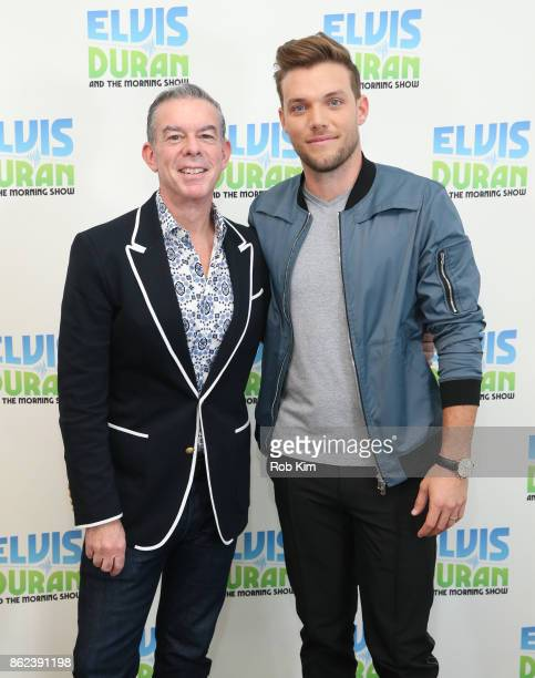 JOHNk and Elvis Duran pose for a photo at 'The Elvis Duran Z100 Morning Show' at Z100 Studio on October 17 2017 in New York City
