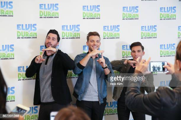 JOHNk enjoys a moment at 'The Elvis Duran Z100 Morning Show' at Z100 Studio on October 17 2017 in New York City