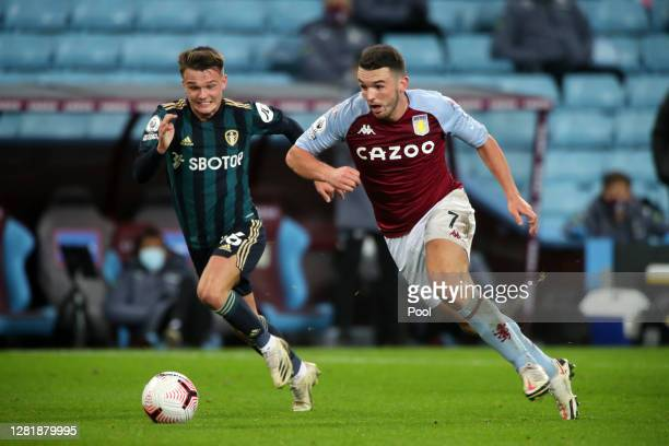 John McGinn of Aston Villa battles for possession with Jamie Shackleton of Leeds United during the Premier League match between Aston Villa and Leeds...