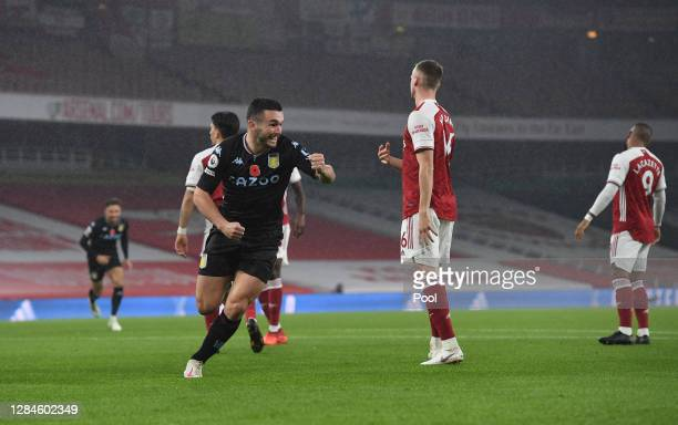 JohnMcGinn of Aston Villa celebrates after scoring his team's first goal during the Premier League match between Arsenal and Aston Villa at Emirates...