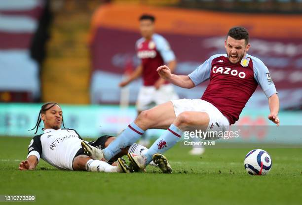 JohnMcGinn of Aston Villa is challenged by Bobby De Cordova-Reid of Fulham during the Premier League match between Aston Villa and Fulham at Villa...