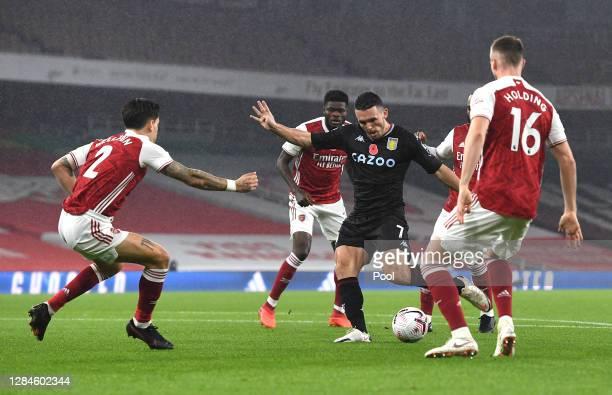 JohnMcGinn of Aston Villa scores his team's first goal during the Premier League match between Arsenal and Aston Villa at Emirates Stadium on...